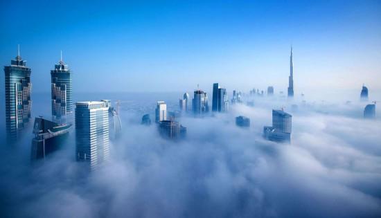 a-blaze-with-light-dubai-in-fog-sebastian-opitz-3