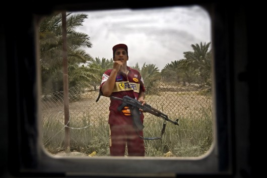Photographs made from behind the window of an armored vehicle.