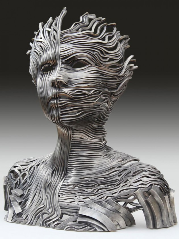 2-girl-face-steel-scultpure-by-gil-bruvel