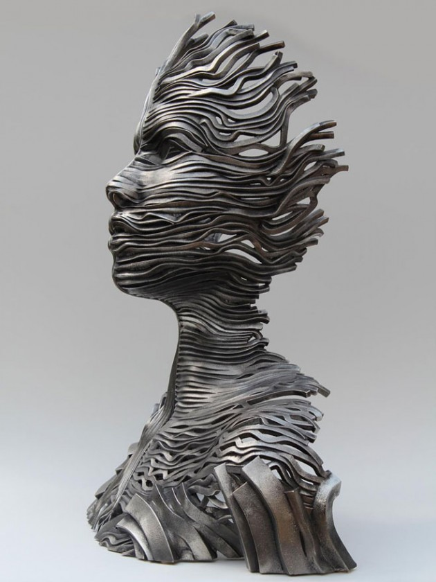3-girl-face-steel-scultpure-by-gil-bruvel
