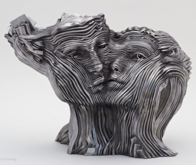4-couple-face-steel-scultpure-by-gil-bruvel.preview