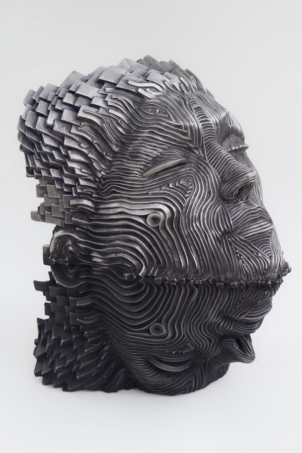 9-man-face-steel-scultpure-by-gil-bruvel