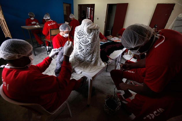 Prisoners knit clothing in the high security prison