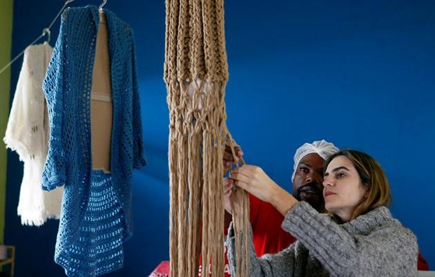 Raquel Guimaraes supervises a prisoner knitting for her
