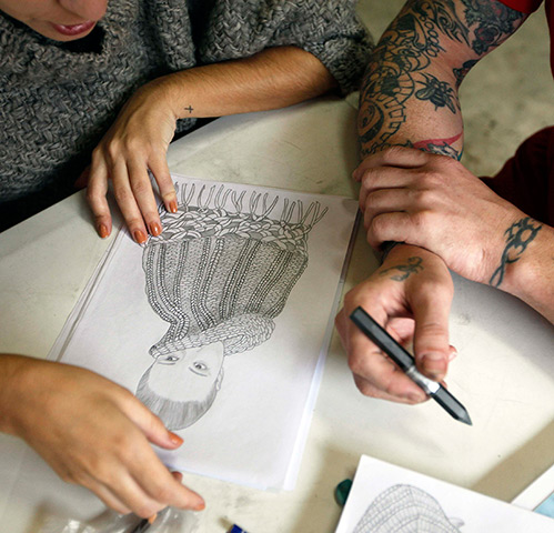 Raquel Guimaraes teaches a prisoner to design knitwear