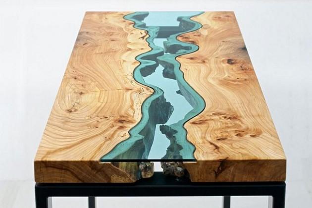 Mesa super criativa com um rio de vidro