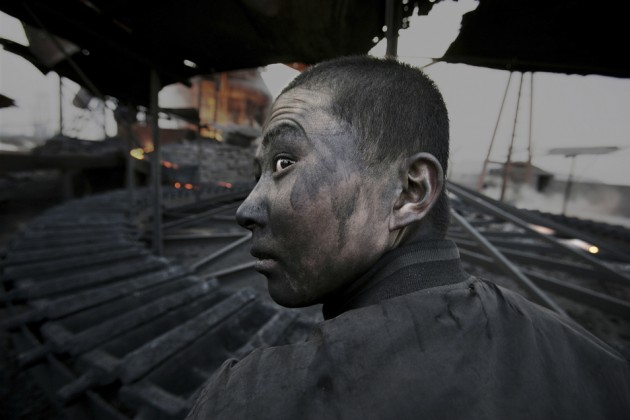 Workers in the factories have no immunity defenses. They get ill after one or two years on the job. Wuhai City, Inner Mongolia.  April 10, 2005