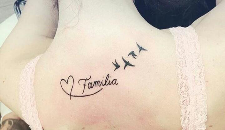 Tatuagens femininas familia nas costas