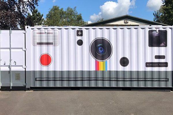 câmera gigante capa